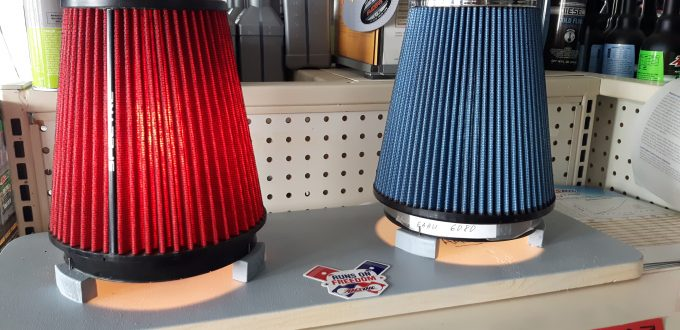 Comparing cold air intake filters with light.